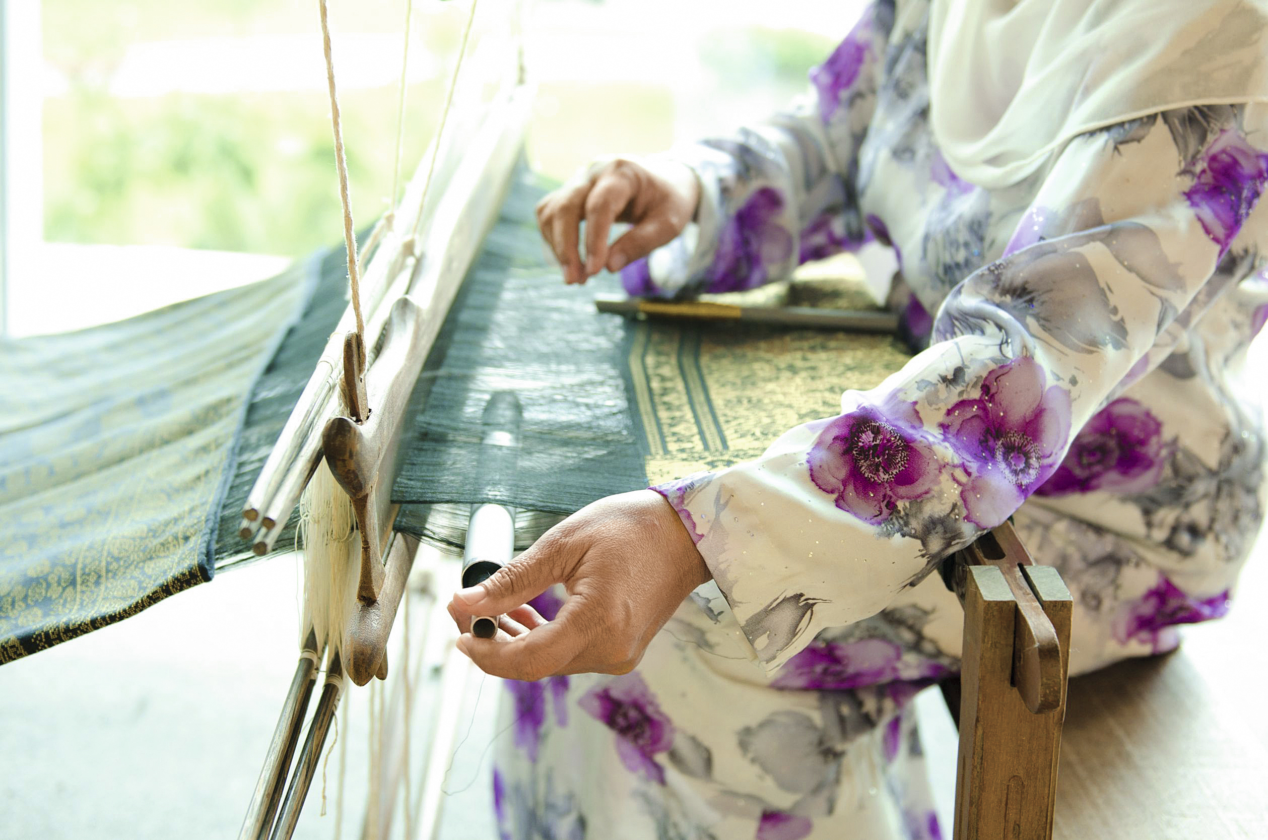 13225040 - the process of traditional songket weaver