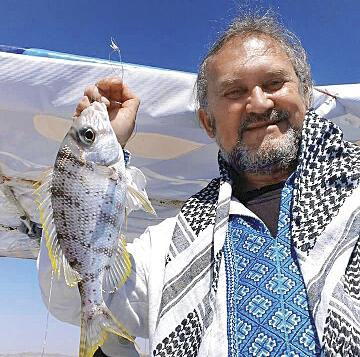 Сашко Лірник наловив стільки риби, що на вечері пригощав нею всіх українців. Фото з архіву Сашка Лірника